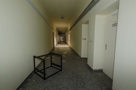 Long corridor in old abandoned hospital