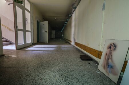 Corridor with a painting of a woman in an abandoned hospital