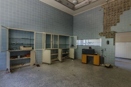 room with tiles and cabinets in an old hospital