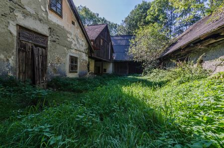Old abandoned farm in the mountains with forest