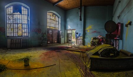 colorful floor with color in an abandoned factory panorama view Standard-Bild