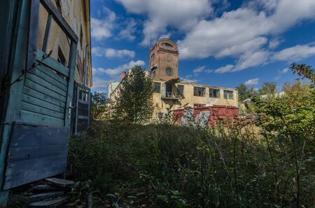 Colorful abandoned factory with a tower and beautiful sky