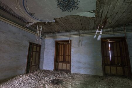 dark castle room with broken decorated ceiling
