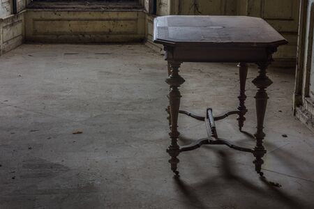 decorated wooden table in an abandoned castle Reklamní fotografie