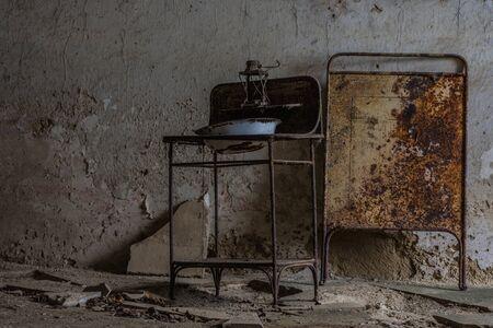 rusty steel sink in a room of a castle