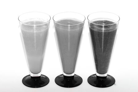 three different gray refreshing healthy drinks smoothie from above