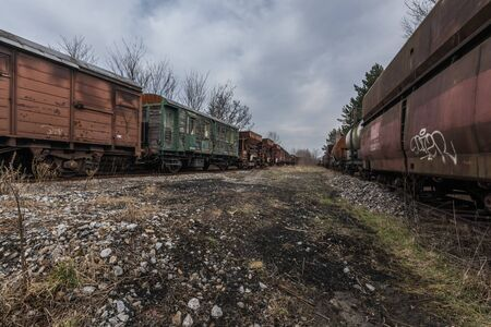 siding with old trains in nature