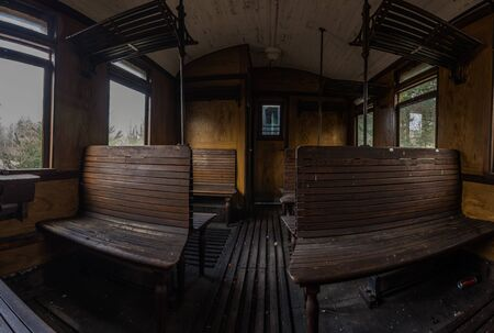 compartment of a wooden train panorama view Imagens