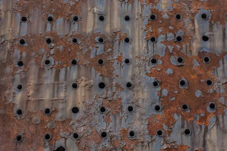 many holes from a rusty old train