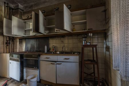 kitchen with cups in an old abandoned house Imagens