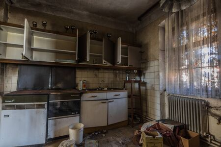 kitchen and open doors with cups in an old house Imagens