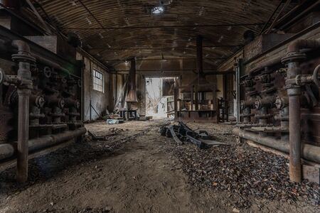 abandoned hall with pipes in a foundry