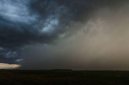 dark storm clouds with heavy rain in summer Standard-Bild
