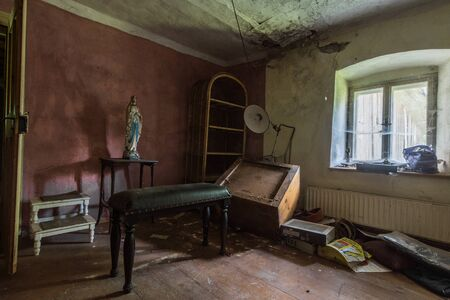 Room with a religious statue in an old mill