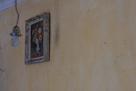 lamp and picture with flowers on a wall in an abandoned house Imagens