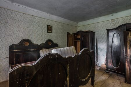 bed and closets made of darkbrown wood in a house Standard-Bild