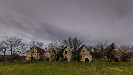 old idential houses on a hill in the nature Imagens