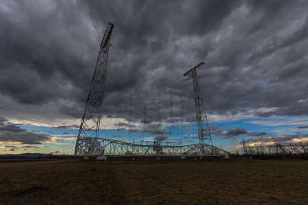 high antenna and dark rainclouds on the sky Banque d'images