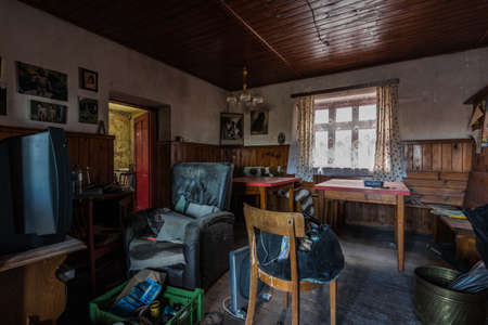 living room with many objects in a house in the country