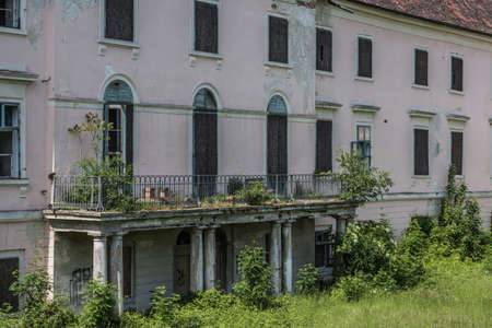 abandoned palace building with balcony over the entrance