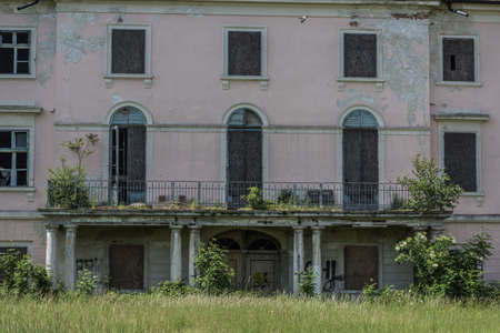 old overgrown facade from a castle with balcony
