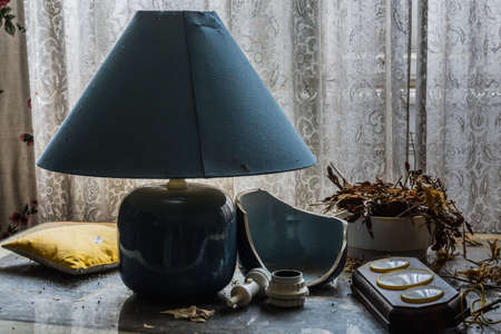 blue lamp and different things in a room from a old house Archivio Fotografico