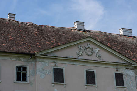 corrugated roof on a abandoned castle with blue sky