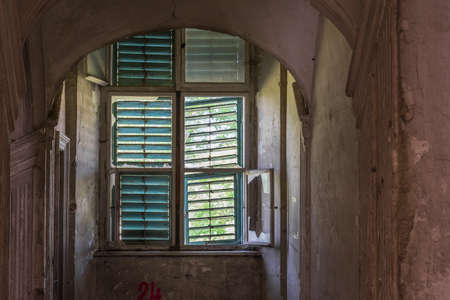 window with wooden sun protection in a abandoned castle
