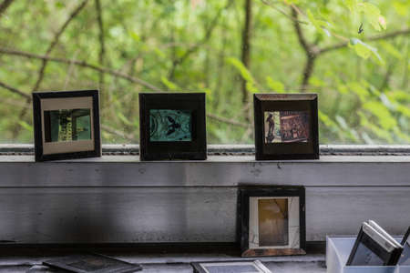 slide photos on a window in a old house detail view