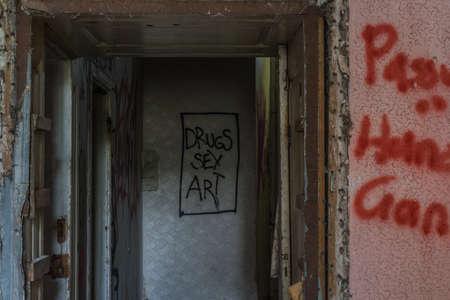 drugs sex art written on a wald in a old castle