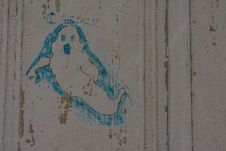 graffiti ghost on a wall in a old castle