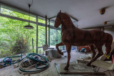 horse statue in a old abandoned house in a forest Archivio Fotografico