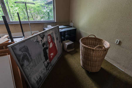 straw basket and picture in a abandoned room