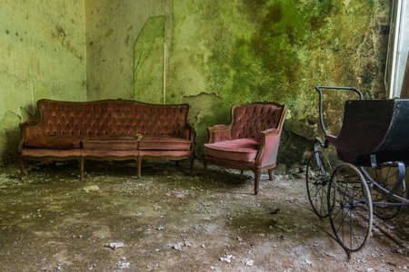 red sofa in a green room from a house Archivio Fotografico
