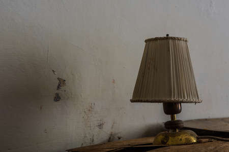 lamp made of fabric and brass in a old house Archivio Fotografico