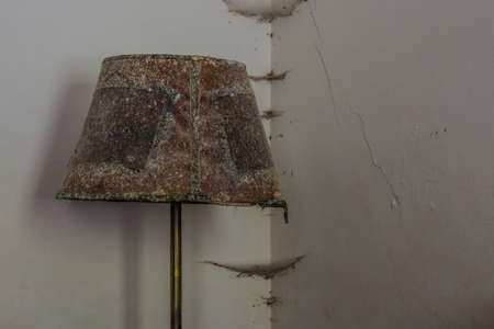 moldy lamp in the corner of a old house Archivio Fotografico