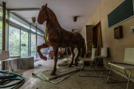 life size statue of a horse in a old house