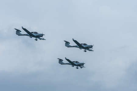 three planes in formation at a air show in the summer