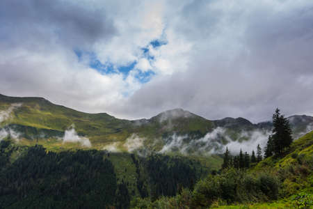 fine white fog in the mountains while hiking in the summer