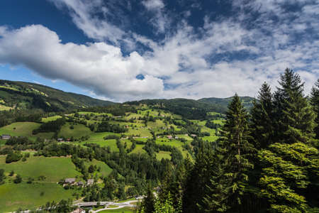 green nature landscape with clouds and blue sky at vacation