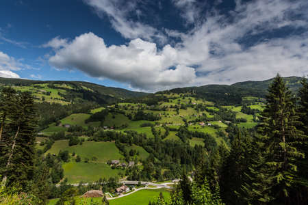 green nature landscape with white clouds and blue sky in the summer Zdjęcie Seryjne