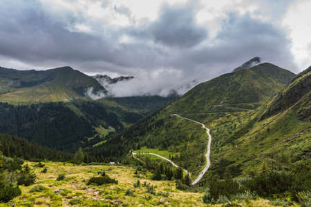 twisting road in green mountains in the summer Zdjęcie Seryjne