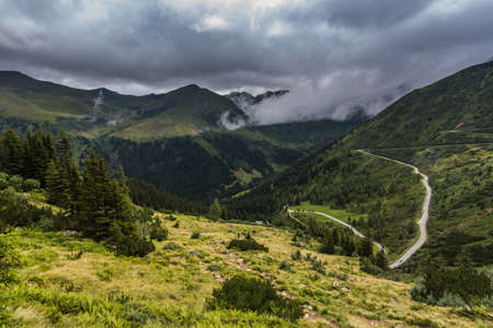 twisting road and beautiful view in the mountains on vacation Zdjęcie Seryjne