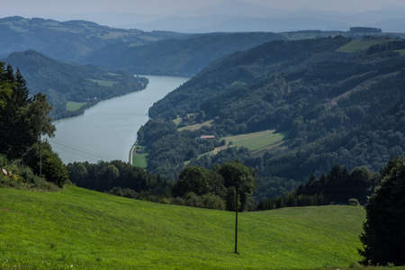 landscape with blue danube mountains and forest in the summer