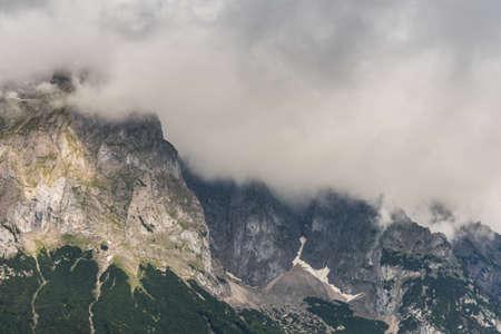 dense fog in a green mountain range in the summer