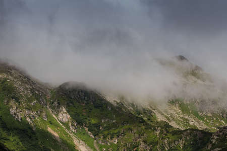 dense white fog in the mountains while hiking on vacation