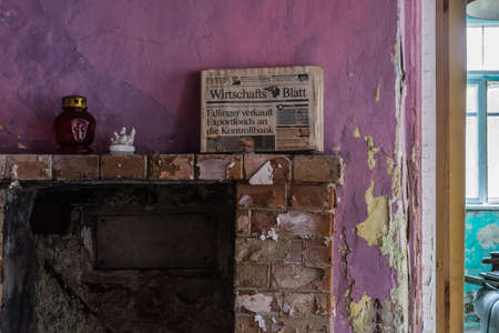 old newspaper on a fireplace in a abandoned house