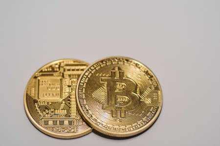 two bitcoins with front and back side view on gray background 写真素材