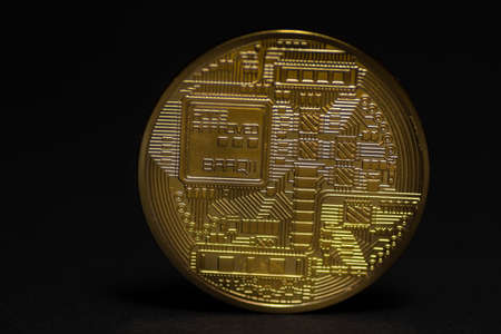 detail from a golden bitcoin back side with black middle view 写真素材