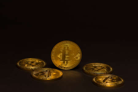golden shiny expensive bitcoins  lying on black background
